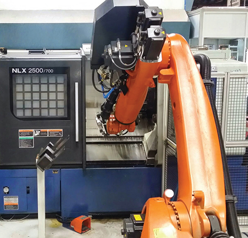 A work cell is formed by two lathes, a marker, a part device detector, the robot and the Equator gauging system.