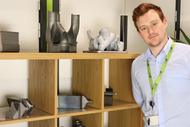 Stephen Mellor pictured with a range of complex additively manufactured components
